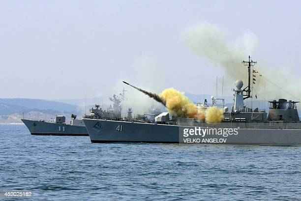 An antisubmarine rocket blasts off a rocket launcher from the Bulgarian navy frigate 'Drazki' during the BREEZE 2014 military drill in the Black Sea...