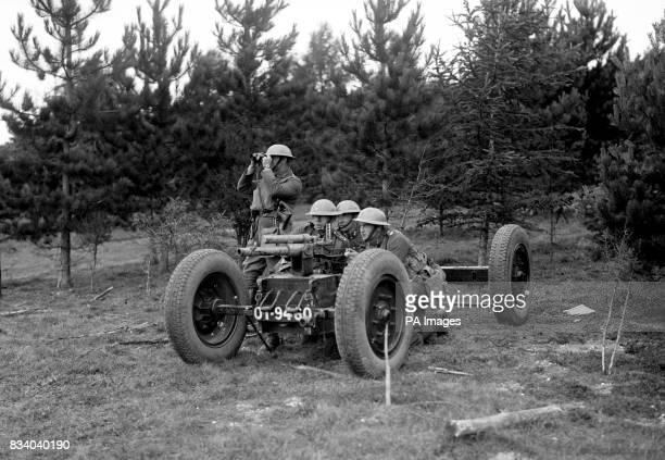 An antitank gun mounted on a pneumatic trolley in action on Salisbury Plain