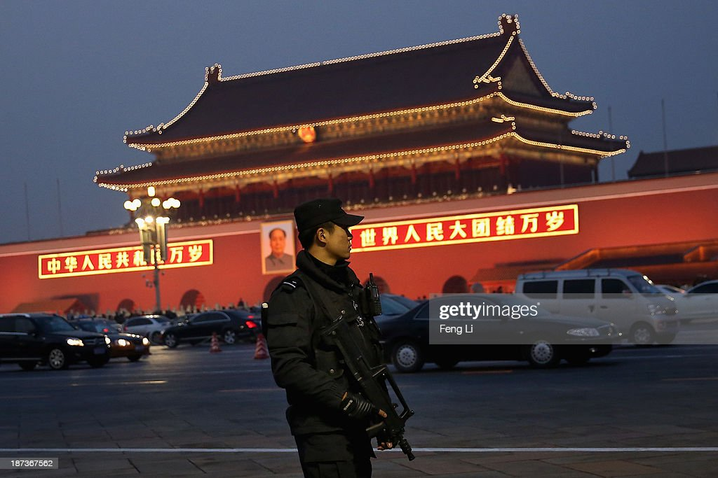 An anti-terror police officer patrols with the gun at Tiananmen Square on November 8, 2013 in Beijing, China. The Communist Party of China (CPC) will convene the Third Plenary Session of the 18th CPC Central Committee from November 9 to 12 to discuss comprehensively deepening reforms.