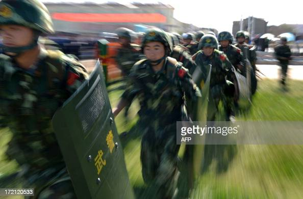 An antiterrorism force including public security police and the armed police attend an antiterrorism joint exercise in Hami northwest China's...