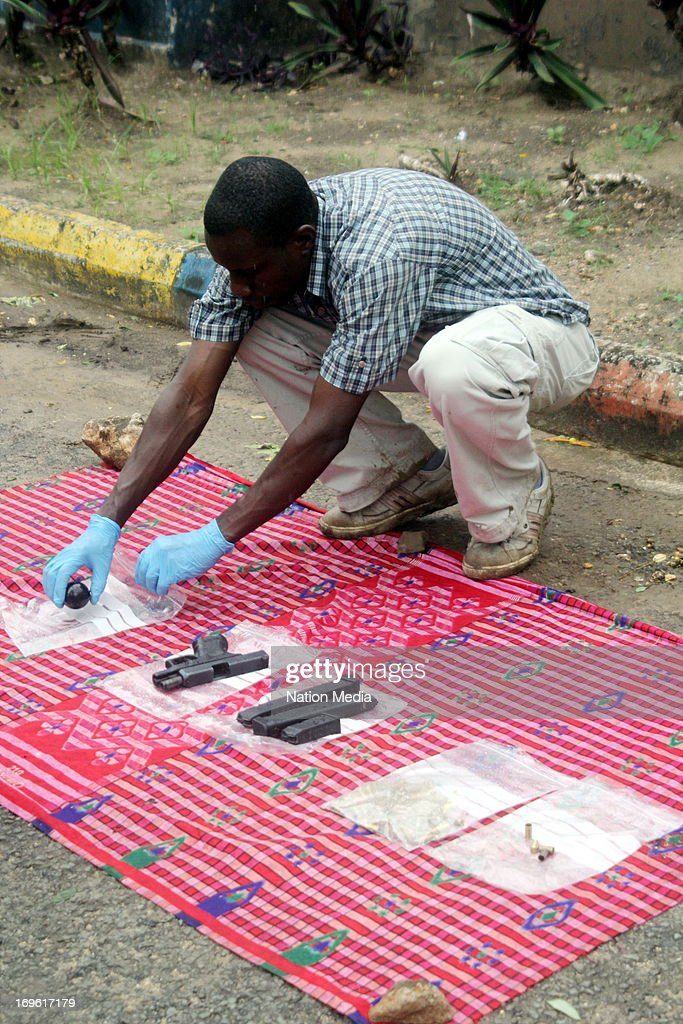 An anti-terrorist officer displays some of the ammunition recovered after gunning down the terror suspect, Khalid Ahmed on May 26, 2013 in Mombasa County, Kenya. The suspected Al-Shabaab member was killed in a gun battle with police at Kwa Bulo on Sunday. It is believed that the suspect was recruiting local youth to the Somalia terror group.