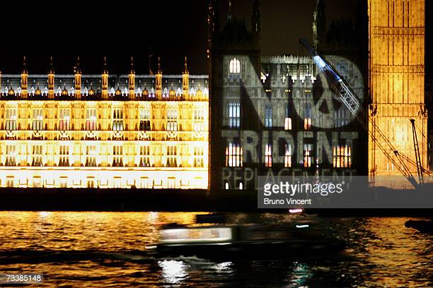 An antiTrident replacement projection illuminates a wall of the Houses of Parliament on February 21 2007 in London England The House of Commons is...