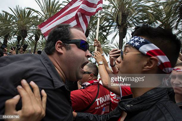 An antiTrump protester and a Trump support clash outside a campaign rally by presumptive GOP presidential candidate Donald Trump at the Anaheim...