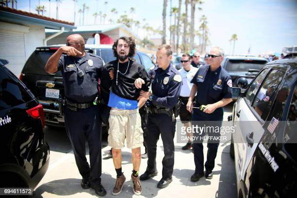 An antiTrump protester is arrested by Police after scuffling with Anti Sharia Law demonstrators during the March For Human rights and Against Sharia...