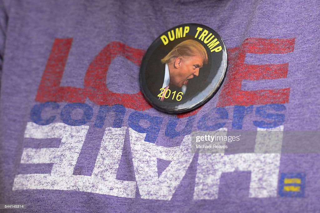 An anti-Trump supporter wears a pin outside the Western Conservative Summit on July 1, 2016.