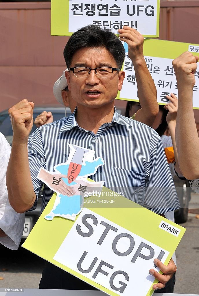 An anti-war activist holds a placard during a rally against South Korea-US joint military exercise, called Ulchi Freedom Guardian, outside a US Army base in Seoul on August 19, 2013. South Korea launched a military drill on August 19 with the United States against a simulated North Korean invasion, even as tensions between Seoul and Pyongyang eased after a series of breakthroughs. AFP PHOTO / JUNG YEON-JE