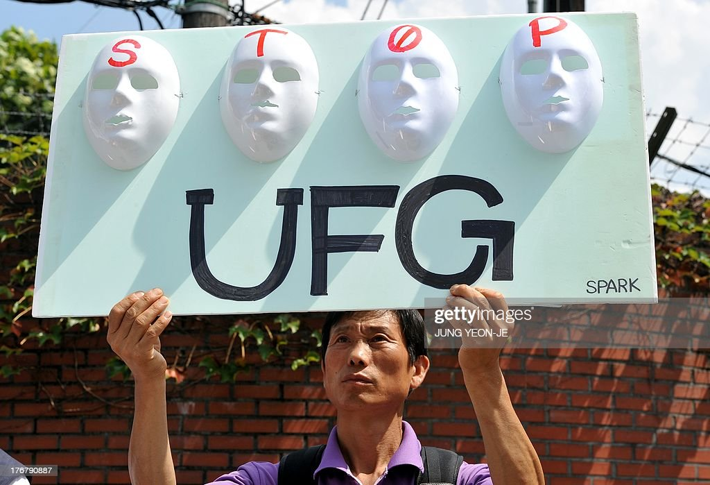An anti-war activist holds a placard during a rally against South Korea-US joint military exercise, called Ulchi Freedom Guardian, outside a US Army base in Seoul on August 19, 2013. South Korea launched a military drill on August 19 with the United States against a simulated North Korean invasion, even as tensions between Seoul and Pyongyang eased after a series of breakthroughs.