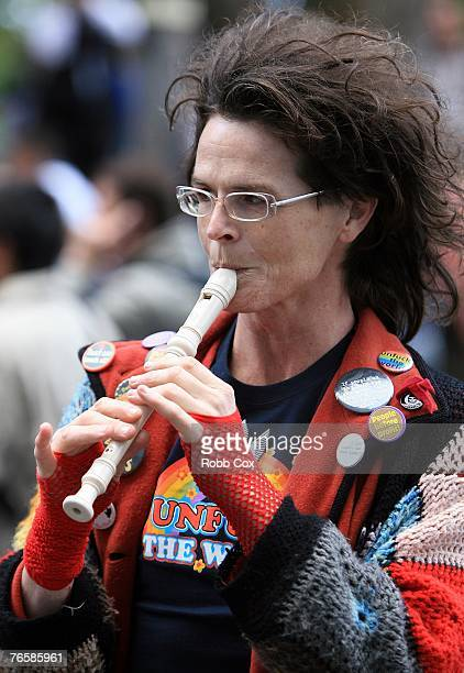 An antiwar protester plays the recorder during a 'Stop Bush Make Howard History Rally' held at Sydney Town Hall September 8 2007 in Sydney Australia...