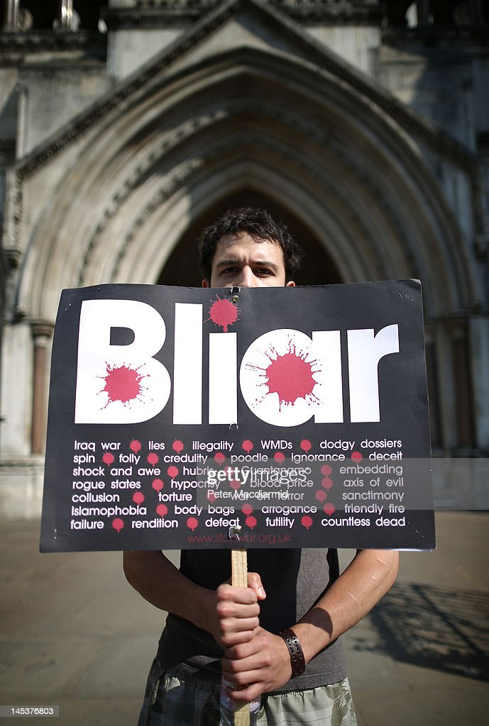 An antiwar protestor stands outside The Royal Courts of Justice as former Prime Minister Tony Blair started to give evidence to the Leveson Inquiry...