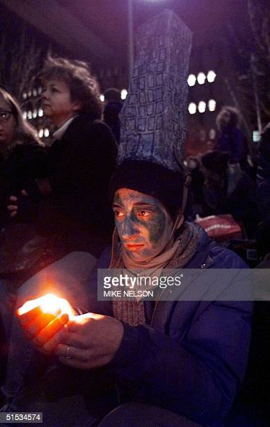 An antiWorld Trade Organization demonstrator sits vigil outside the King County Jail in downtown Seattle WA where hundreds of her fellow arrested...
