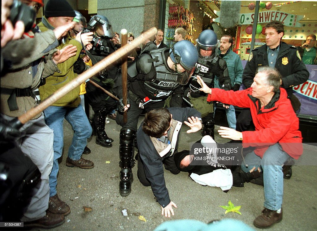 An antiWorld Trade Organization demonstrators resist arrest by Seattle riot police during the second day of protest against the WTO meetings 01...