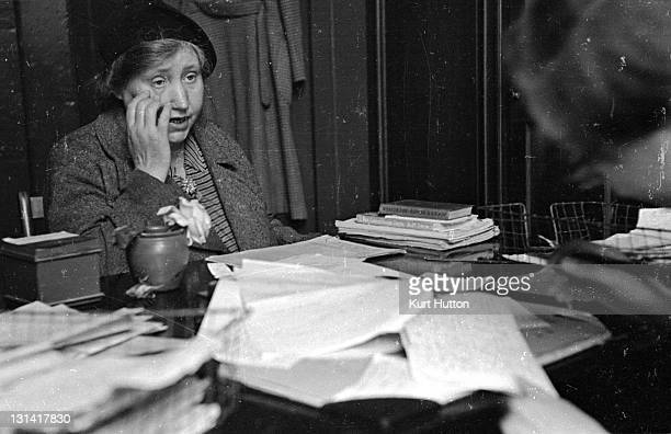 An anxious woman talking to an adviser at the Citizens' Advice Bureau at Poplar east London about a wartime problem She would like know how have her...