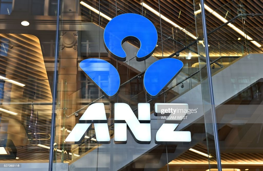 An ANZ sign adorns a branch of the bank in Sydney on May 3, 2016. Bank on May 3 posted an interim net profit slump of 22 percent on the back of impairment and restructuring charges that the lender said would reposition it for the future. / AFP / WILLIAM