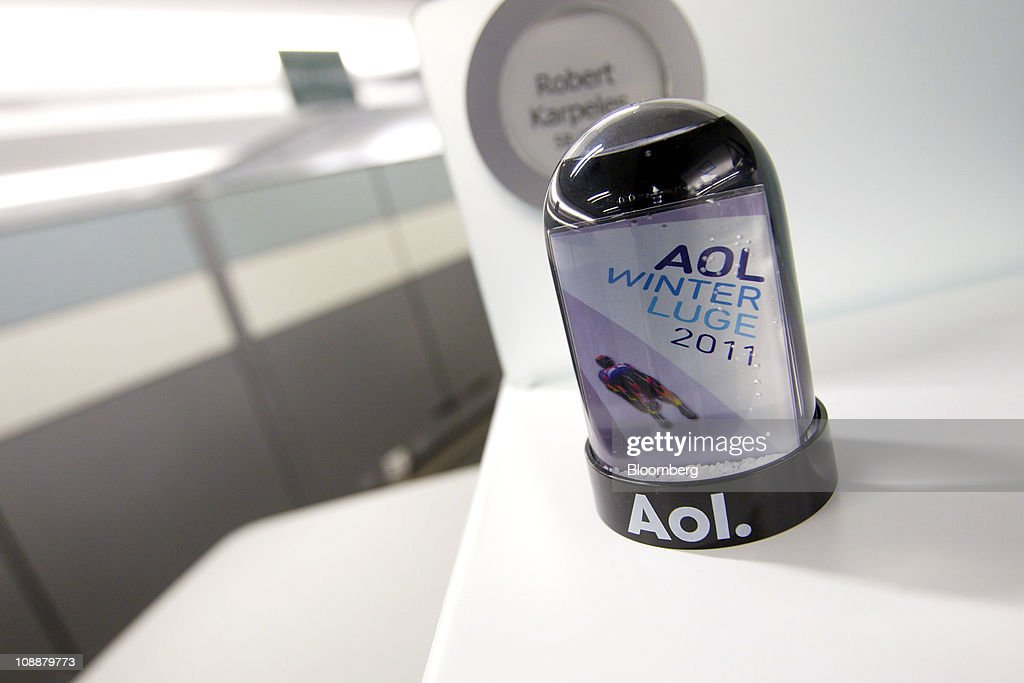 An AOL Inc. branded snowglobe is displayed at the company's headquarters in New York, U.S., on Monday, Feb. 7, 2011. AOL agreed to buy the Huffington Post for $315 million as the internet company spun off from Time Warner Inc. increases its investments in online content to help revive growth in advertising revenue. Photographer: Jin Lee/Bloomberg via Getty Images