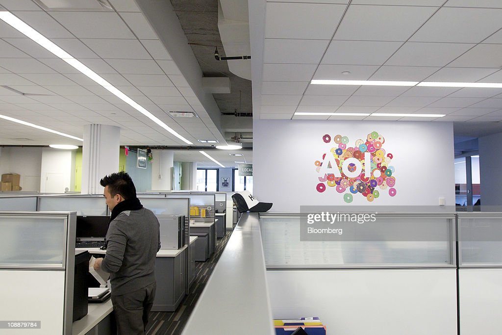 An AOL Inc. employee works at the company's headquarters in New York, U.S., on Monday, Feb. 7, 2011. AOL agreed to buy the Huffington Post for $315 million as the internet company spun off from Time Warner Inc. increases its investments in online content to help revive growth in advertising revenue. Photographer: Jin Lee/Bloomberg via Getty Images
