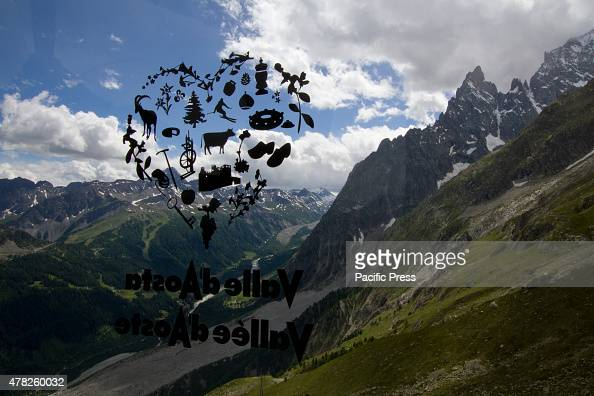 An Aosta Valley sticker on the window of the cableway gondola overlaps Val Veny landscape The new Skyway cable car connecting the city of Courmayeur...