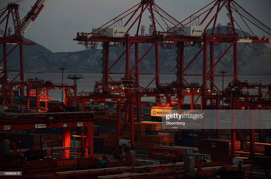 An A.P. Moeller-Maersk A/S shipping container is moved with a crane at the Yangshan Deep Water Port, part of China (Shanghai) Pilot Free Trade Zone's Yangshan free trade port area, at dusk in Shanghai, China, on Wednesday, Oct. 23, 2013. The area is a testing ground for free-market policies that Premier Li Keqiang has signaled he may later implement more broadly in the world's second-largest economy. Photographer: Tomohiro Ohsumi/Bloomberg via Getty Images
