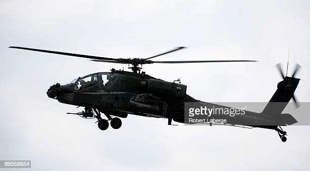 An Apache helicopter hovers over the race track during pre race ceremony before the start of the IRL IndyCar Series Meijer Indy 300 on August 1 2009...