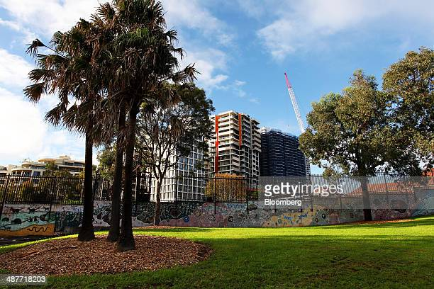 An apartment tower right stands under construction behind a mural featuring Aboriginal dot painting on Eveleigh Street in the inner city suburb of...
