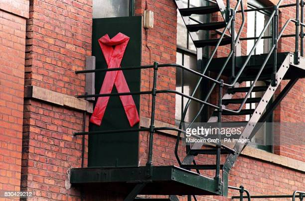 An apartment with a huge red Aids ribbon stuck on its door in Canal Street Manchester a famous gay district of the city