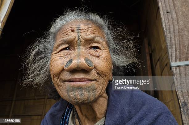 An Apatani woman with the traditional bamboodiscs in her nostrils This custom was done to prevent the young Apatani women from being abducted and is...