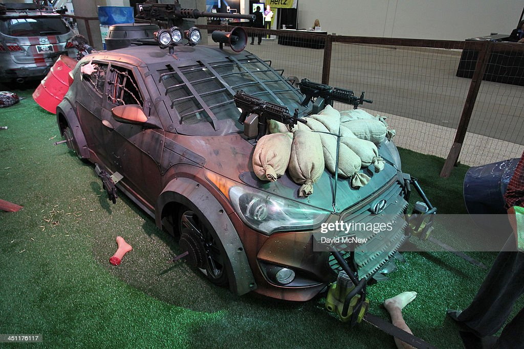 An apocalyptic zombie scene displays so-called Hyundai Veloster and Hyundai Santa Fe Survival Machines during media preview days at the 2013 Los Angeles Auto Show on November 20, 2013 in Los Angeles, California. The LA Auto Show was founded in 1907 and is one of the largest with more than 20 world debuts expected. The show will be open to the public November 22 through December 1.
