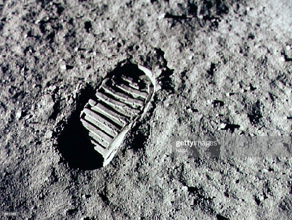 An Apollo 11 astronaut's footprint in the lunar soil photographed by a 70 mm lunar surface camera during the Apollo 11 lunar surface extravehicular...