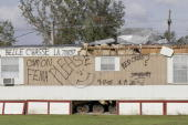 An appeal to the Federal Emergency Management Agency and the Red Cross is written on a trailer home damaged in hurricane Katrina 25 September 2005 in...