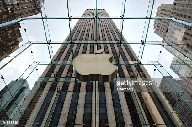 An Apple Computer Inc logo hangs in the center of a clear glass cube marking the entrance to the new Apple Store in New York Thursday May 18 2006 The...