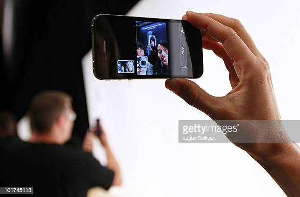 An Apple employee demonstrates 'Face Time' on the new iPhone 4 at the 2010 Apple World Wide Developers conference June 7 2010 in San Francisco...