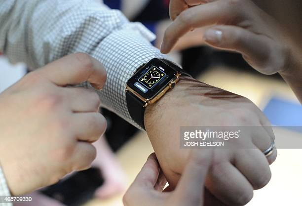 An Apple employee demonstrates how to use an Apple Watch during an Apple media event at the Yerba Buena Center for the Arts in San Francisco...