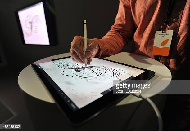 An Apple employee demonstrates how to use the new Apple Pencil for the iPad Pro at a media event in San Francisco California on September 9 2015...