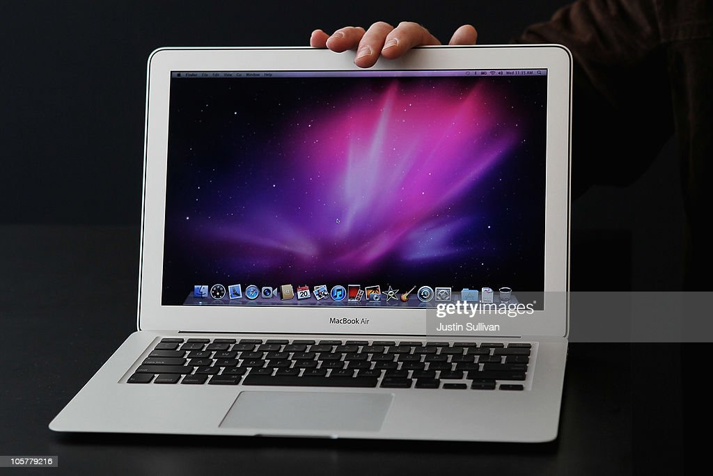 An Apple employee displays the new MacBook Air during an Apple special event at the company's headquarters on October 20, 2010 in Cupertino, California. Apple CEO Steve Jobs announced the new MacBook Air in eleven and thirteen inch models starting at $999. He also announced the OSX Lion operating system for Mac computers.