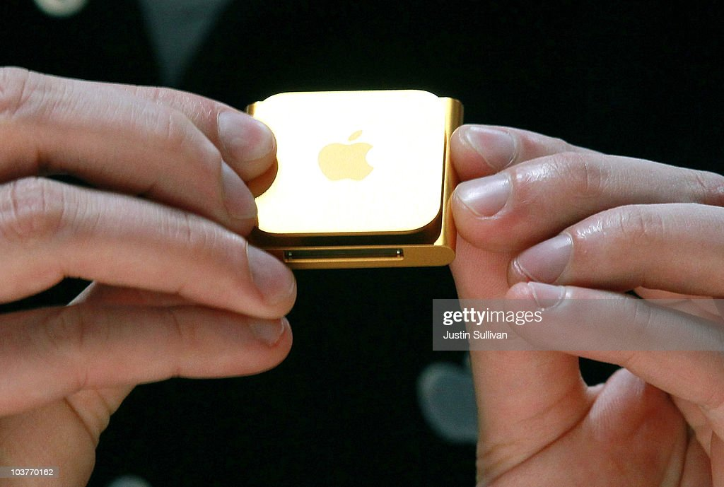 An Apple employee holds a new iPod Nano at an Apple Special Event at the Yerba Buena Center for the Arts September 1, 2010 in San Francisco, California. Apple CEO Steve Jobs announced upgraded versions of the entire iPod line, including an iPod Touch that includes a camera and smaller version of Apple TV.