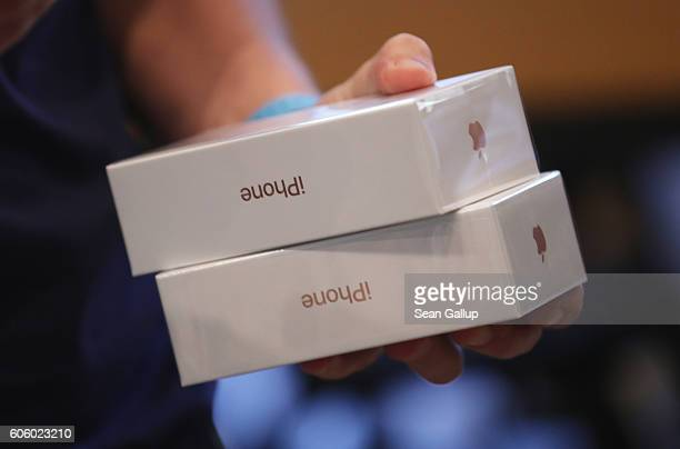 An Apple employee prepares Apple iPhone 7 phones on the first day of sales of the new phone at the Berlin Apple store on September 16 2016 in Berlin...