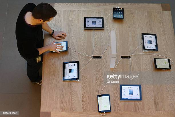 An Apple employee uses a new 'iPad mini' on the morning of the tablet's launch in the Apple Store in Covent Garden on November 2 2012 in London...