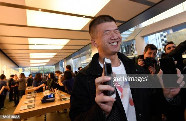 An Apple fan shows the newly released iPhone X at the Sanlitun Apple Store on November 3 2017 in Beijing China iPhone X go on sale on Friday and...