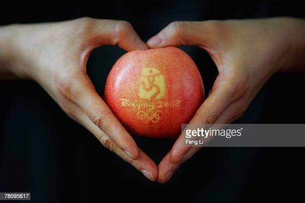 An apple featuring the Beijing 2008 Olympic logo and Olympic rings is shown during the China International Forestry Exhibition on December 20 2007 in...