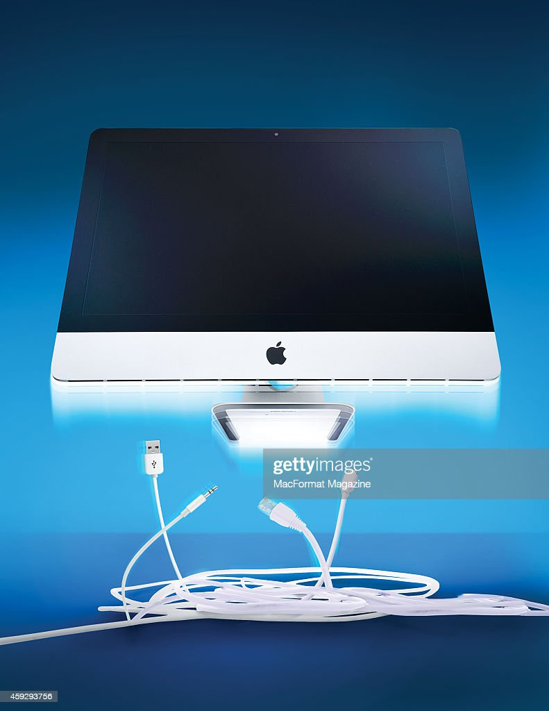 An Apple iMac computer photographed floating above a bundle of white cables for a feature on removing wire clutter taken on April 7 2014