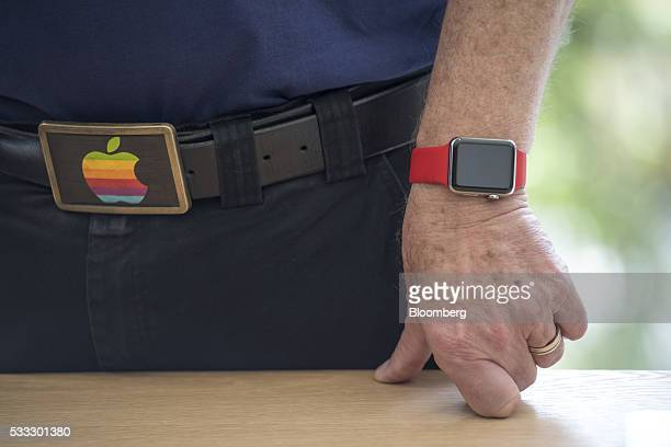 An Apple Inc employee wears an Apple Watch Sport model and a belt buckle with the Apple logo during the grand opening of the company's new flagship...