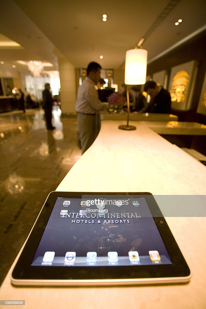An Apple Inc. iPad displaying the InterContinental Hotels Group Plc logo is seen at the InterContinental Hotel in London, U.K., on Tuesday, May 25, 2010. The popularity of the iPad will spur a sixfold increase in industrywide shipments of tablet computers by 2014, research firm IDC said. Photographer: Chris Ratcliffe/Bloomberg via Getty Images
