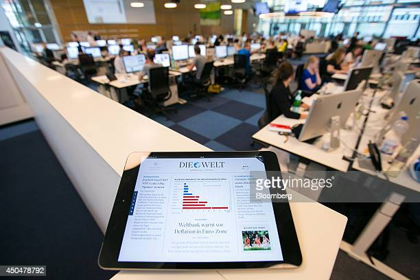 An Apple Inc iPad displays the Die Welt web page inside the broadsheet newspaper's newsroom at the offices of publisher Axel Springer SE in Berlin...
