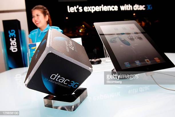 An Apple Inc iPad right sits on a counter at a Total Access Communication Pcl exhibition stand at the company's headquarters in Bangkok Thailand on...