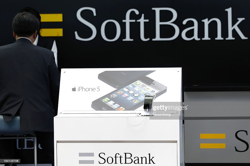 An Apple Inc. iPhone 5 is displayed at a counter for Softbank Corp. outside an electronics store in Tokyo, Japan, on Monday, Oct. 15, 2012. Softbank agreed to pay $20.1 billion to acquire about a 70 percent stake in Sprint Nextel Corp. as Japan's third-biggest mobile-phone operator seeks growth overseas amid a declining local market. Photographer: Kiyoshi Ota/Bloomberg via Getty Images