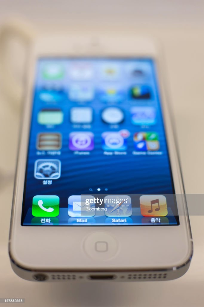An Apple Inc. iPhone 5 sits on display during a launch event organized by SK Telecom Co. in Seoul, South Korea, on Friday, Dec. 7, 2012. The iPhone 5 went on sale in South Korea today. Photographer: SeongJoon Cho/Bloomberg via Getty Images