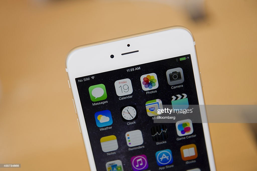 An Apple Inc iPhone 6 Plus is displayed during the sales launch at an Apple store in Palo Alto California US on Friday Sept 19 2014 Apple Inc's...