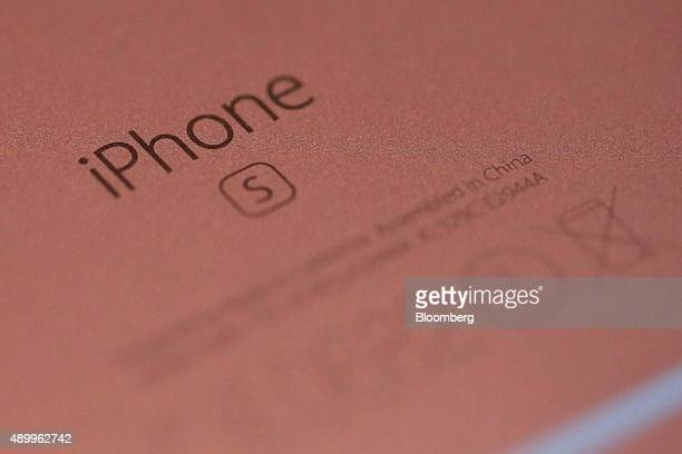 An Apple Inc iPhone 6S smartphone device in rose gold sits on display at the Apple Inc store at Covent Garden in London UK on Friday Sept 25 2015 The...