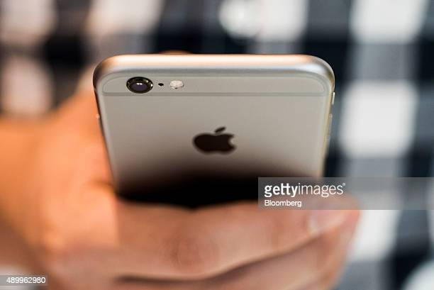 An Apple Inc iPhone 6S smartphone is held for an arranged photograph in Hong Kong China on Friday Sept 25 2015 The latest models following last...