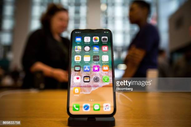 An Apple Inc iPhone X smartphone is displayed during the sales launch at a store in New York US on Friday Nov 3 2017 The $1000 price tag on Apple...