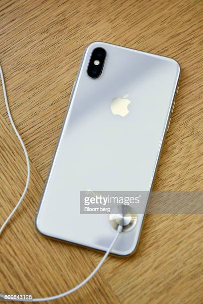 An Apple Inc iPhone X smartphone is displayed during the sales launch at a store in San Francisco California US on Friday Nov 3 2017 The $1000 price...